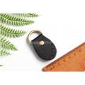 Ручкодержатель для ручки сумки черного цвета в виде овала 3см*4.5см с кольцом на конце